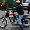 Triumph Bonneville in red and white with rider