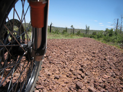 Not a happy surface for riding motorcycles. Near Show Low, AZ on the Mogollon Rim Road.