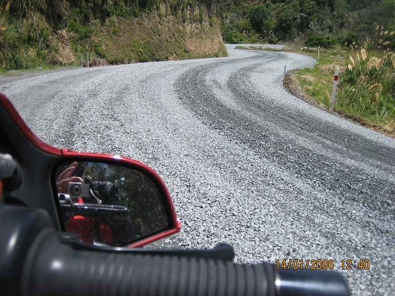 Off 'Sealed' Road - Experiences ... <br /> <br /> Only about 80% of New Zealand's roads are 'sealed' with a tarmac surface. The other 20%, that get you to some of the more fascinating locations, are simply raked dirt sprinkled with gravel. Look closer at the reflection in the wing mirror – How cool is that, huh? This picture was taken at 12:40pm …