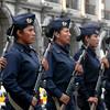 Policia Femenina de Arequipa a las ordene de su jefe, hoy domingo 24-01-10 preparandose para bajar las banderas y guardarlas (del Peru y de la Ciudad).  Se muestra su patriotismo y su temple.