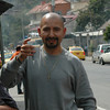 Jimmy Haro brindando una copa de mapanagua (Guarapo con trago).