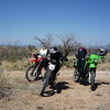 The bikes take a break after we try some southern routes towards Arivaca. <br /> <br /> After many miles of sand, we rethink the situation and head back to the east-west powerline road.