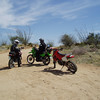 After a brisk ride down Mission Road, we blast past the San Xavier del Bac Mission, and travel through the slab legal portion of the Tohono O'Odham Nation's Reservation along Mission Road.    <br /> <br /> A quick meeting of the minds at the crossroads, here...