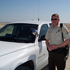 "Mark the park ranger. Like all employees I encountered at Chincoteague, he was friendly and helpful, although evidently prohibited from smiling for the camera. After I parked the Tiger, he pulled in behind me. He got out and right away said, ""You're not doing anything wrong, I just wanted to look at your bike."" (The Tiger provokes comment and conversation everywhere. People love to talk about it, or their own Triumph, or their dad's, etc. It's a fun way to meet people.) Anyway, Mark has a BMW that he hopes to one day ride across country too.<br /> <br /> Chincoteague itself looks like a great place for a family vacation. It's flat, and has a lot of bicycle trails to get to the beaches. Once there you can play on the beach, of course, and also do things like kayak. Apparently mosquitos are a plague in the summer, though"