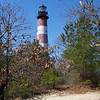 This is the US Coast Guard Lighthouse. It's obsolete--not because of technology, but because the topography of the sand dunes around it has changed so much in the past century and a half that the lighthouse is now too far away from the shore to be useful. The ocean has eaten away at some of the shore but also created new shoreline