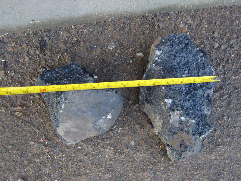 ...and some of the debris (large chunks of road surface/tarmac!) that had come out of the hole