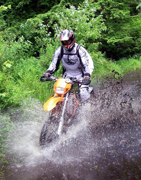 Jeff rides mucky Maine muck, summer 2007
