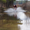Kevin Hirnak crosses a flooded road near Pats Peak NH