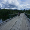 Joe crosses the Rose River on the Canol Road, Yukon Territory.