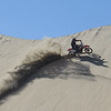 Bruce Anderson cuts a line up a big dune on his XR650R,  Baja 2014