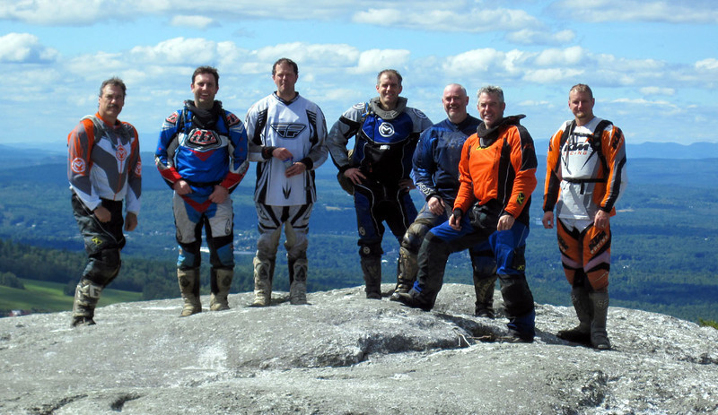 """The """"Maine Crew"""" up high on some rock pile in Maine."""