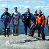 "The ""Maine Crew"" up high on some rock pile in Maine."