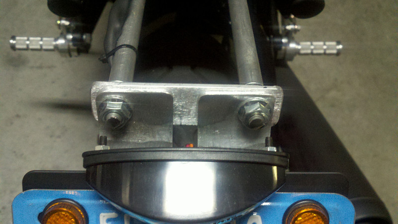 "To attach the tail light I use two 5/16 threaded rods, 8"" long. You can slide some alu tubing over top if you like. Once tight I bend up to proper place under seat. All this stuff you can pickup at your local hardware store. Oh and you'll have to drill an additional hole to run your tail light wires into the pan"