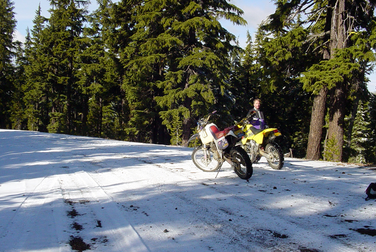 "Here we are on the rim of Newberry Crater, ready after several years of attempting this same ride, to actually head down to East Lake.  Yes, that's snow on the ground, but we found that the undriven on snow at the edges was actually sort of grippy, so on we went.  I saw on the yahoo group <a href=""http://autos.groups.yahoo.com/group/Oregon_DSR/"">Oregon_DSR</a> that some folks I'm familiar with tried but didn't make it to or past this point on the very same day..  How did we miss each other?!  ;-)  Better yet, you let this little bit of snow turn you back!?"