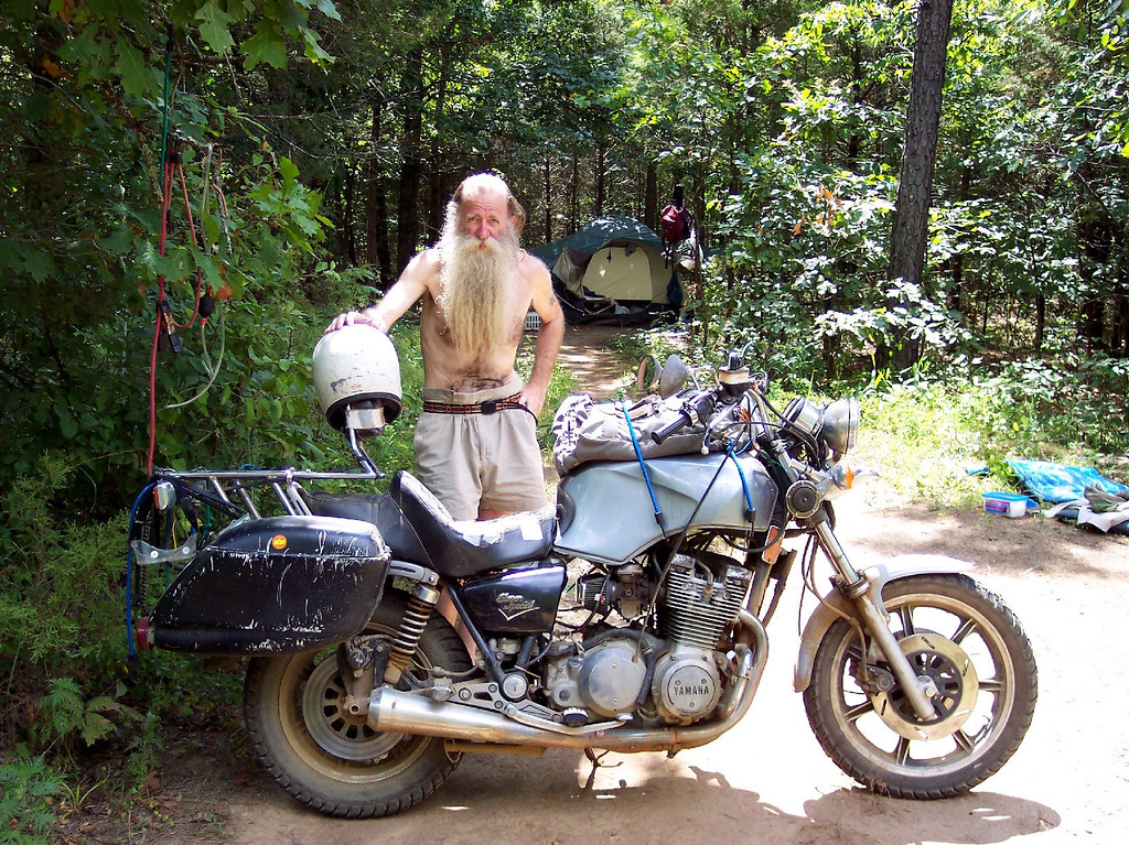This could be me...or you.  This guy was interesting to say the least.  If I remember correctly he had been a realtor in his earlier years and it sounded like he made some money.  Then at some point he just started living off the motorcycle.  he was camped out in the Ozarks....and had been in this spot for the last 10 months.  He had this cool old Yamaha and a lot of very low tech get the job done cheaply but effectively gear. He even had a walmart email, but when I emailed him recently the address bounced.