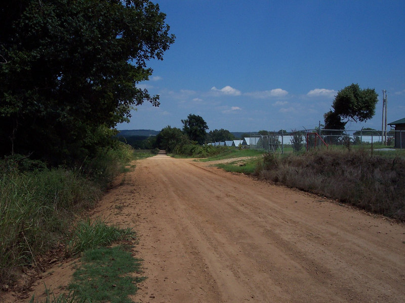 Welcome to Oklahoma where its flat, the roads are straight, and we dont have any humidity.  To make up for the lake of humidity it will be 120 deg F...enjoy your stay, oh and we have very little shade so enjoy it when you find it.  (this pic looks East)
