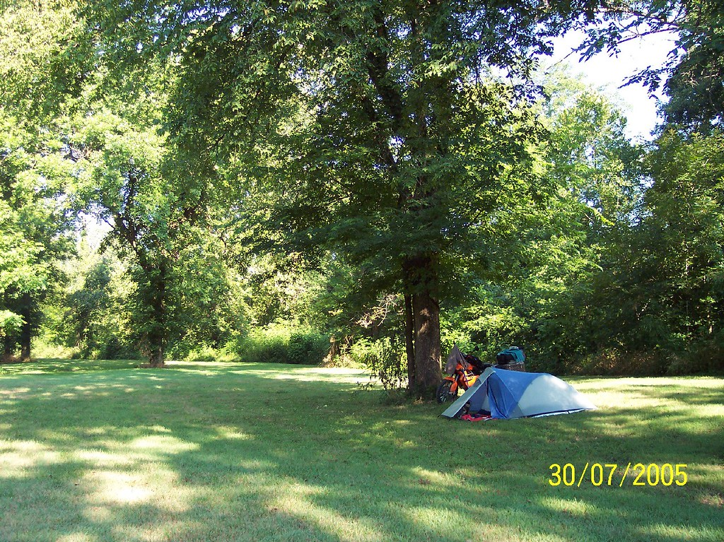 "Spent the night hear shortly after the above flat tire.  The primitive camping was great....wide open, nice grass, quiet.  The RV area was a zoo and very sketchy....course I like my privacy and solitude when I camp.  nothing worse then waking up to the jackass turning on his generator so he can watch the ""game""."