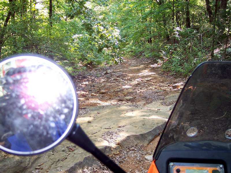 """Other then one loose gravel stretch in mississippi this was my first """"technical"""" section. Like all good pictures this one doesnt reveal how steep and loose the trail was.  I  even had the pleasure of getting around some big trees further down....in future carry folding saw.  The bike was a handful with the stock front tire...but I didnt dump it."""