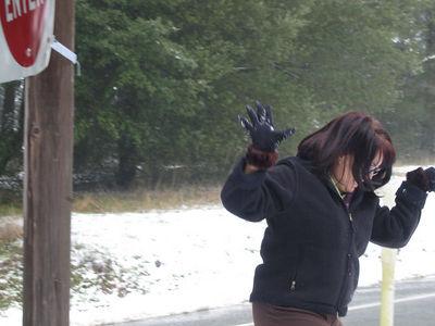 03/12/06 Hwy 9 at Hwy 35. Karen running from the onslaught of Mojo's snowballs.