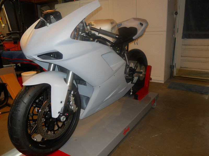 Still not sure what color to paint a faux Supermono.  Still waiting for the Puig double bubble wind screen.