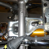 "It is so much easier to remove the rear shock with the motor out of the chassis.  A redesigned (monoposto) link from Dan Kyle . . .  -  <a href=""http://kyleusa.com"">http://kyleusa.com</a> . . . gives better control to the shock."