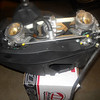 We pop the coupling linkage off the ball on the TPS (throttle position sensor) on the front carburetor.