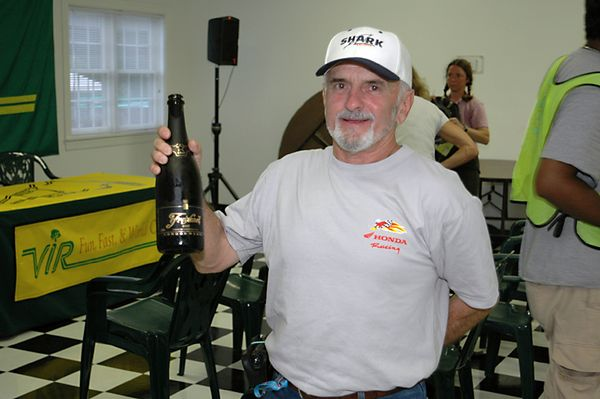 Yvon Duhamel finishes his son's bubbly after Miguel collected the win in Formula Extreme.