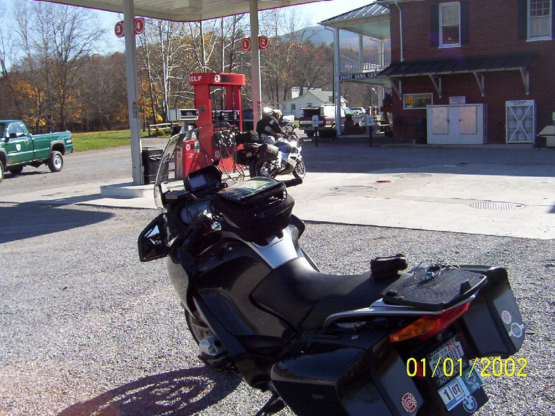 Seth and Hank met at Hangin Rock, then rode to Paint Bank for breakfast at the Swingin' Bridge. Seth is filling up the K-RS after breakfast. Its 36 deg.