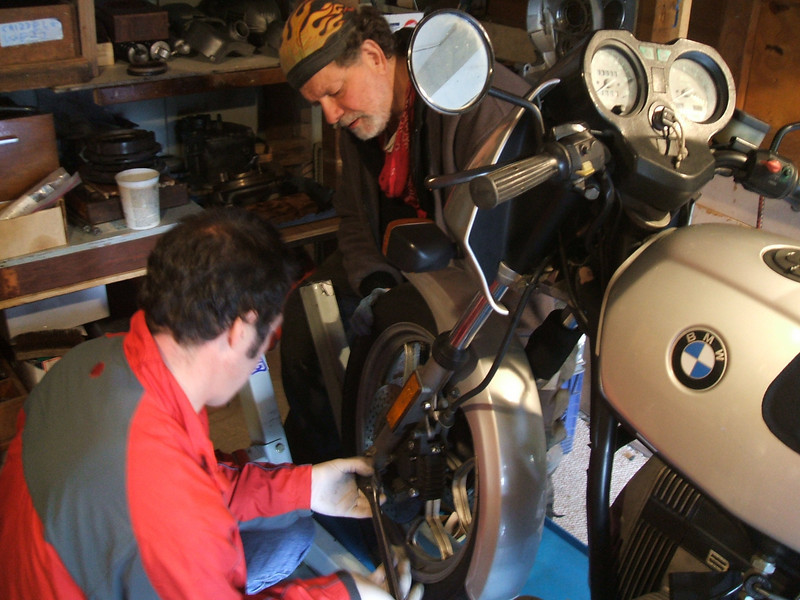 Domenico, left,  and Keith  starting to pull front end off Domenico R65 LS for Fork seal replacement