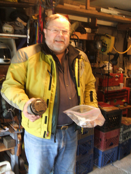 John Falconer and his freshly removed piston  from cyclinder that dropped a valve seal on the way to tech day that morning. . . .