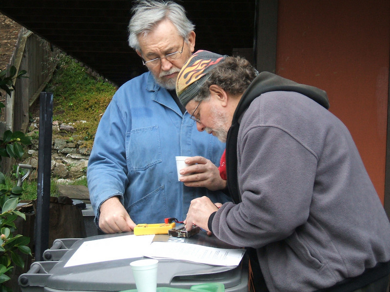 """L to R. : Dale Schuett and Keith """"Holmes"""" Karn, bench testing a diode board"""