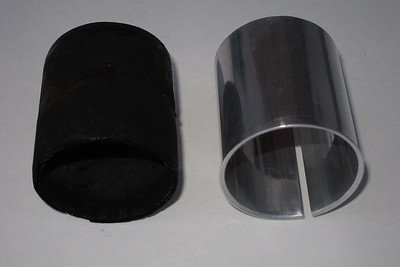 The exhaust gaskets between the header pipes and the front muffler.  The gasket on the right is made out of aluminum and is the newer style replacement for the gasket on the left. The gasket on the left is used and of the style used in the past.