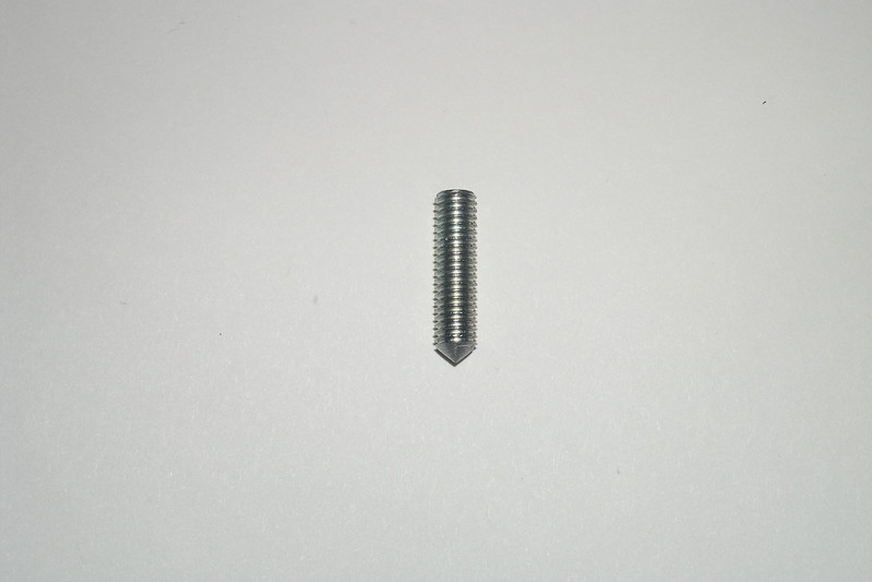 This 2.5 cm long M6 x 1.00 threaded stud that has been modified was used to mark the location of the hole that was drilled in the starter cover. It can be made from a bolt that has had its head cut off.<br /> <br /> One end was filed to a point by either using a lathe or by placing the stud in a drill press or hand drill. While the stud was rotating, the end was filed to a point.
