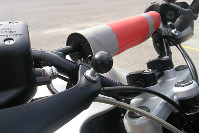 A modified RAM-B-236 ball was installed on the right handguard to mount a still or video camera.  I had previously installed a modified RAM-B-236 ball on the left handguard to mount my GPS. It is also visible in the photo.  The BMW R1150 GS Adventure RAM Ball Install can be found on the following link: http://edelweiss.smugmug.com/gallery/2787876_EwKq3#148883087_juvRT