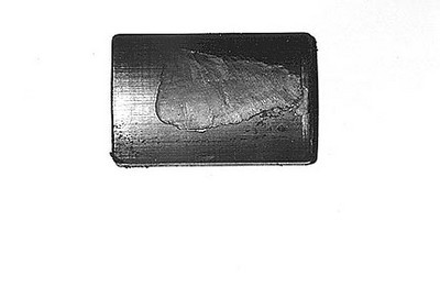 This is a view of the magnet. Note the missing material on the mating surface which can be seen in the photo above.