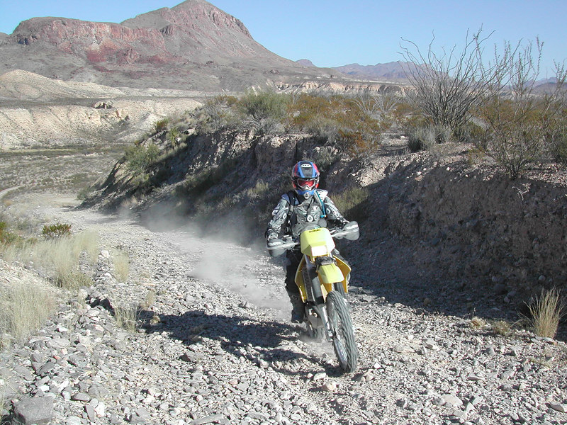 John heads up the big hill after crossing Terlingua Creek<br /> way down in the valley below