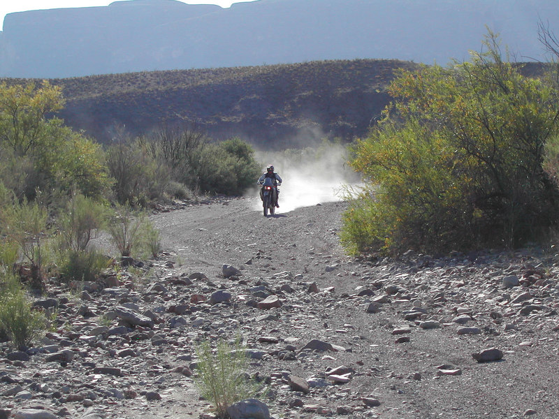 Carl on his 640 Adventure heading up River Road with Santa Elena Canyon in the background