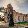 Mission San Juan was established in San Antonio in 1731.  The chapel and bell tower are still in use. Note the archway at the entrance gate and the remains of a half-completed,  church that was begun in 1772 and abandoned in 1786 when the mission's population declined.