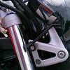 Lower windshield mount on headlight bracket
