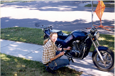 Checking the oil on the Suzuki before a run down the Gallatin Hwy to Big Sky. I spent many happy days learning how to ride fast on curvy roads aboard the ol' VX800.
