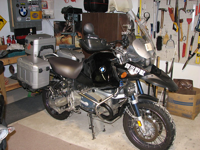 2004 BMW R1150GS Adventure.  New seat upholstery.  Jet coated exhaust pipes. Removed the GS stickers from the tank. Color scheme is now black and grey/silver rather than black and yellow.  Other mods: Wilbers suspension, Remus exhaust, Cee Bailey windscreen, bar risers, PIAA driving lights mounted to Terra Nova bracket.