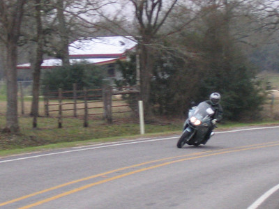 My buddy Ray on FM3090 riding his first bike, a K1200GT. Around 20,000 miles in his first year!