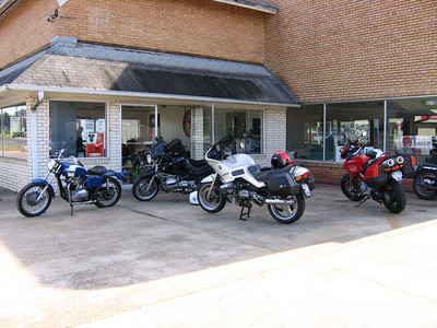 """Randy, Steve and my (black BMW) bikes in front of a cool bike/fabrication shop in Colmesniel, TX on the """"Piney Woods 500"""" in May 2005. This was my last ride with Steve, may a great rider and friend rest in peace"""