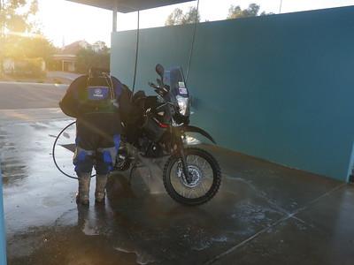 Andy washing the bike at Jamestown