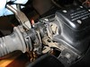 """part of it needs to be cut off.  The new """"repair"""" kit from BMW changes the way the throttle cable is enclosed as it attaches to the grip pulley.  It all makes more sense when you have it in your hand."""