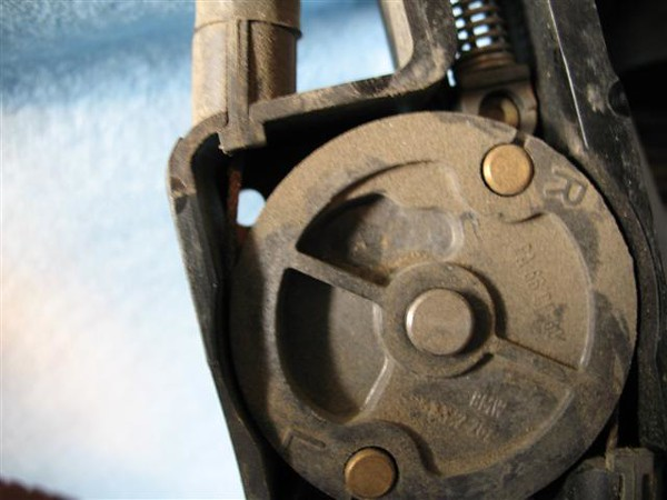 circlip removes to allow the wheel to slide up for access.