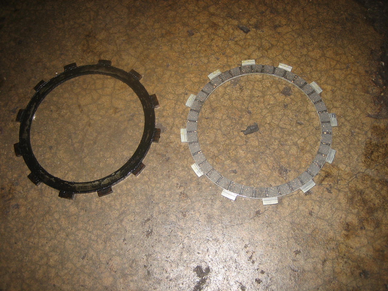 Old friction plate (left) and new friction plate (right)