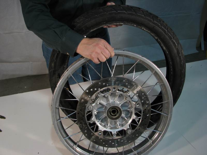 "Tires have a ""direction of rotation"".  So does your rim.  You have to match them so they're rotating in the same direction"