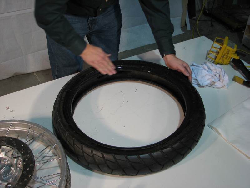 I smooth out the BeadGoop, making sure it is evenly applied to the entire bead.  Be careful that you don't get any BG inside the tire carcass, because that can affect the use of Dyna Beads