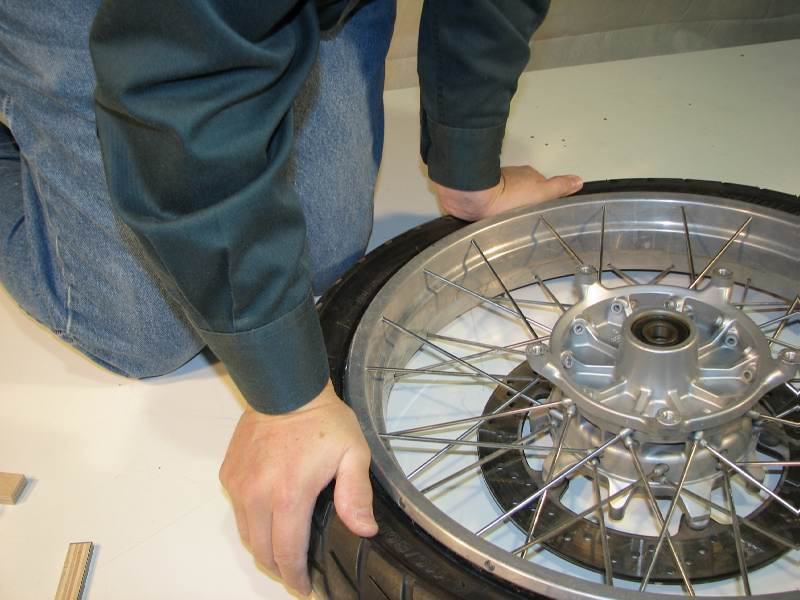 Again I use my hands and knee to press the tire away from the reim
